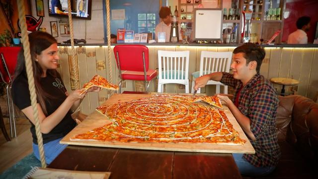 This restaurant serves pizza that's the size of a table